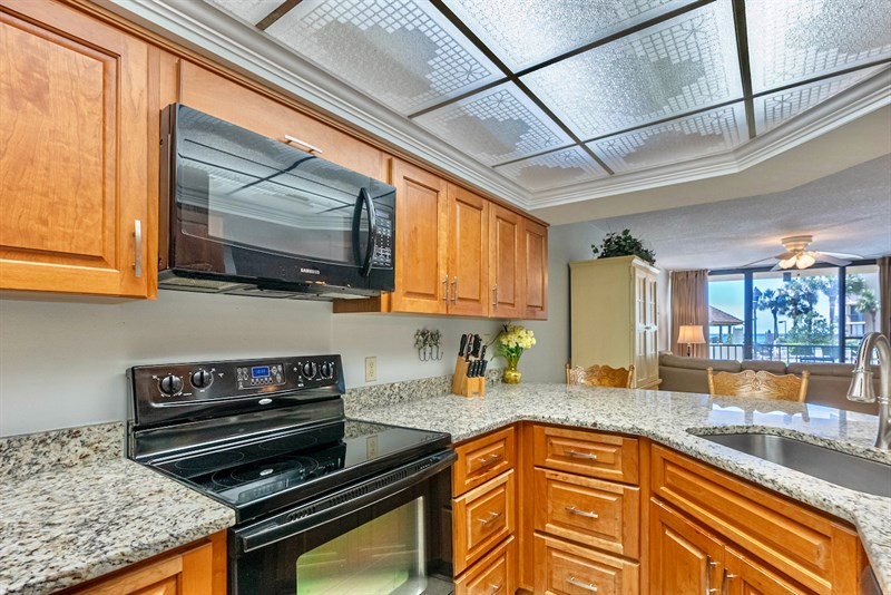 Updated appliances and beautiful Cherry cabinets and granite in the kitchen.